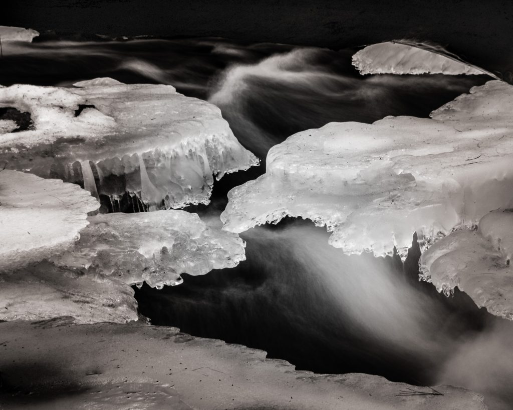 ice ledges formed over a creek