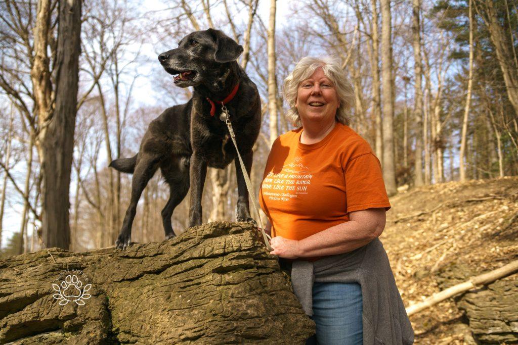 on alert- black dog and owner