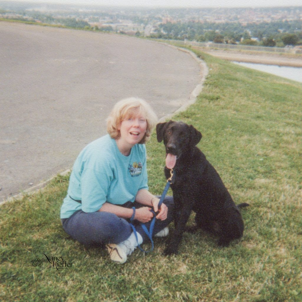 woman and her black dog