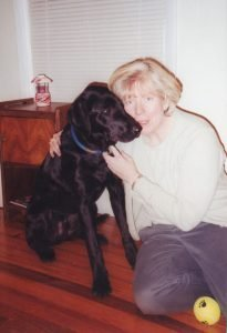 woman and black dog
